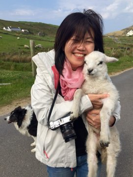 Lay Eng Yeo in love with a lamb on Muckross Head in Donegal