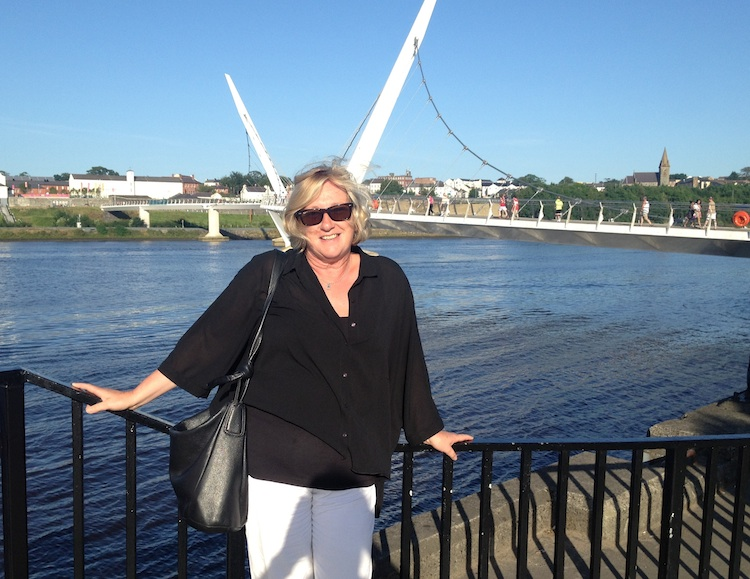 Susan Byron, with the Peace Bridge in Derry in the background.