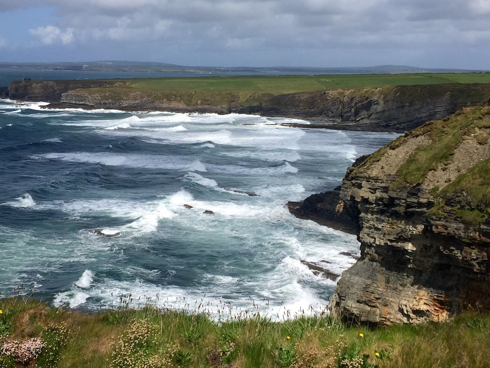 Big Atlantic waves rolling into the Bromore Cliffs in County Kerry