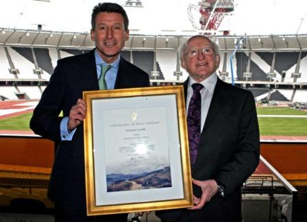 President Michael D Higgins presents Sebastian Coe with his Certificate of Irish Heritage